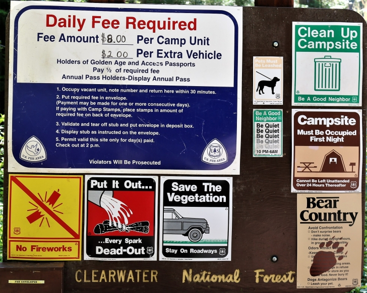 A picture of some of the campground information signs at Giant White Pine Campground.