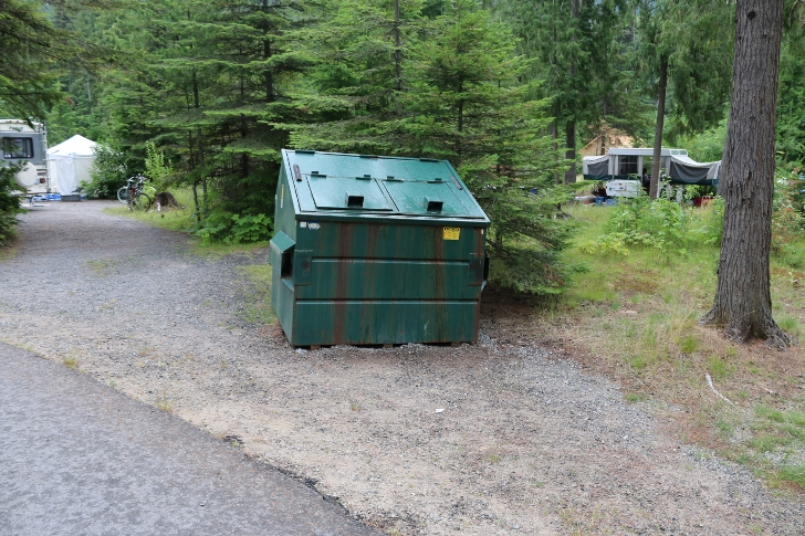 Garbage dumpsters are scattered throughout the campground.