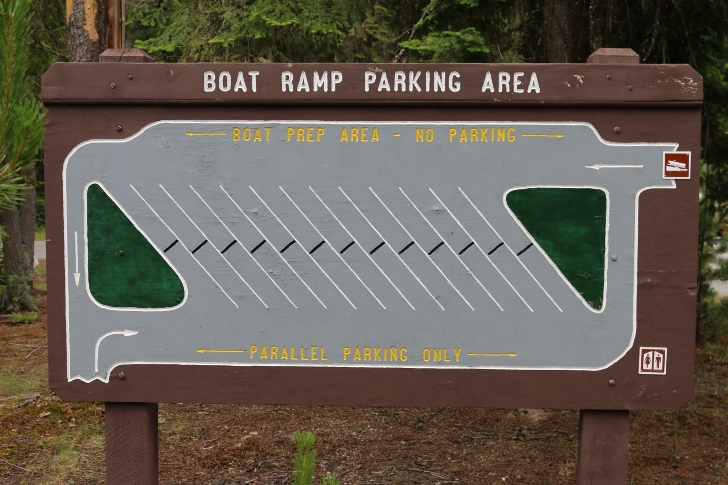 This sign diagrams the layout of the boat launch with parking.