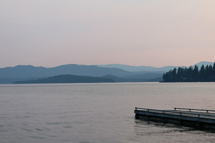 The dock, lake and distant mountains.