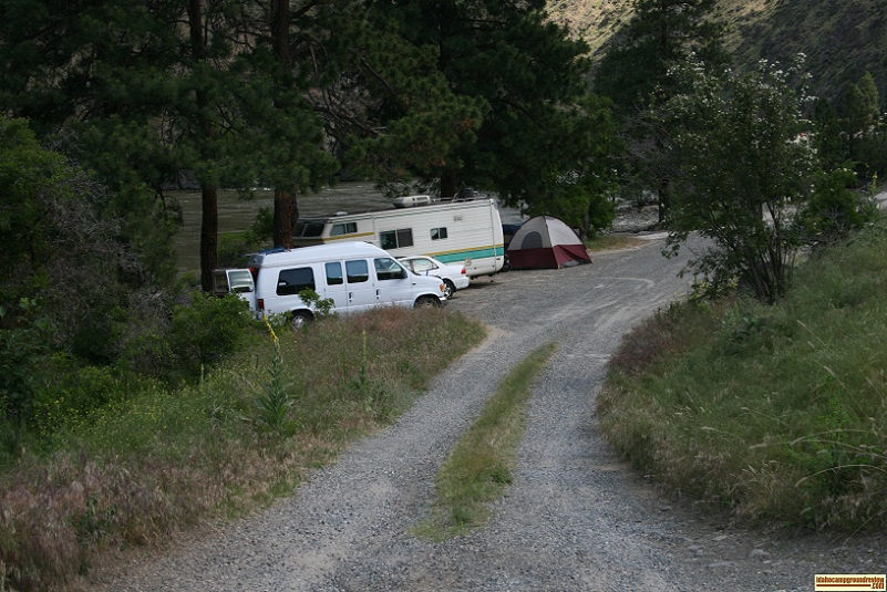 Lightning Creek is undeveloped, note RVs parked in a row.