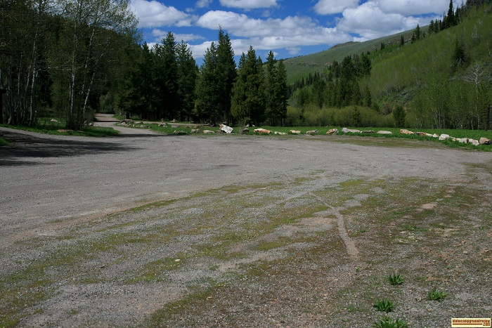 At the entrance there is a large parking area in Lower Penstemon Campground.