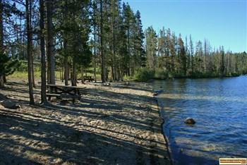 view of the cute little beach at Pettit Lake Campground on Petit Lake.