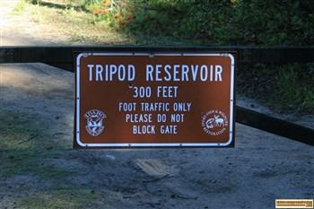 Tripod Reservoir gate and sign
