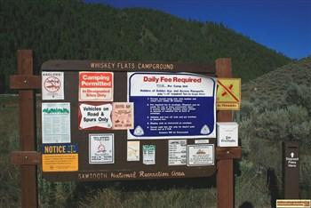 The information sign with camping rules and warnings at Whiskey Flats Campground.