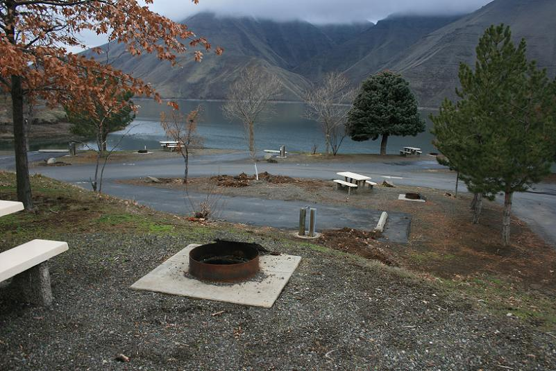 Picture of typical campsites in Woodhead Park Campground with Brownlee reservoir in the background.