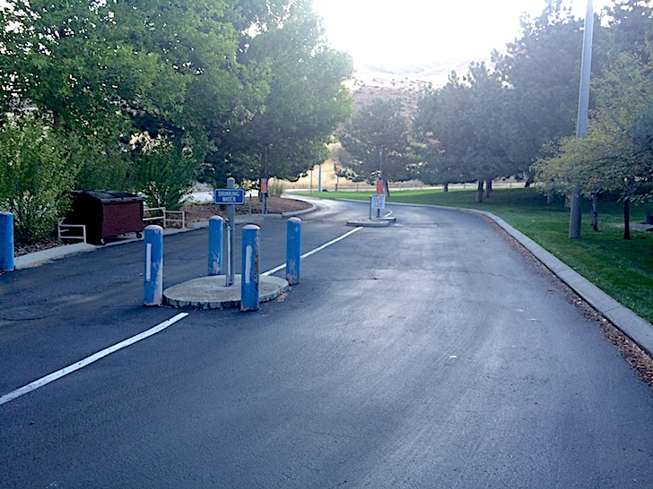 A picture of the RV dump station at the entrance to Woodhead Park. It is free to campers.