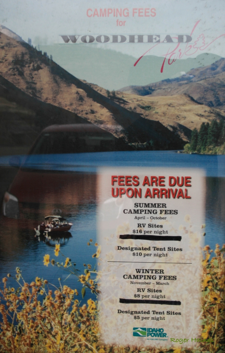 A picture of a poster with the camping fees for Woodhead Park.