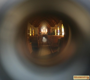 View of the interior of the Silver City Church through the front door peephole.